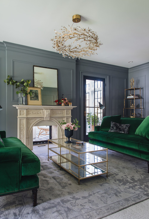 Gray living room with green velvet couches