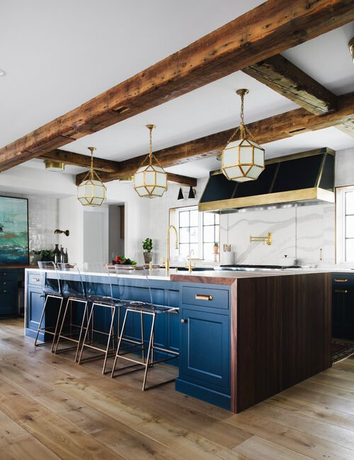 Large modern farmhouse kitchen with dark blue cabinets