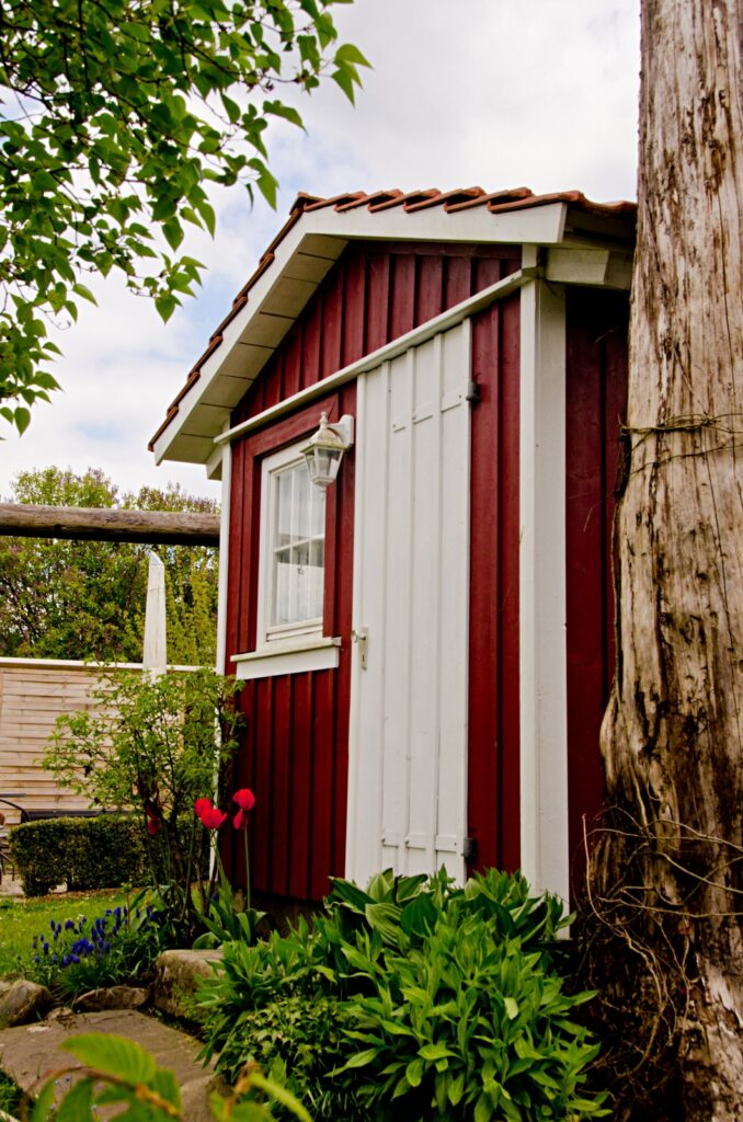 Small red shed for gardening and utensils