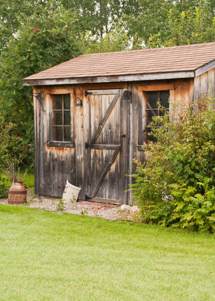 A charming, rustic garden shed made from reclaimed timber (barn board)