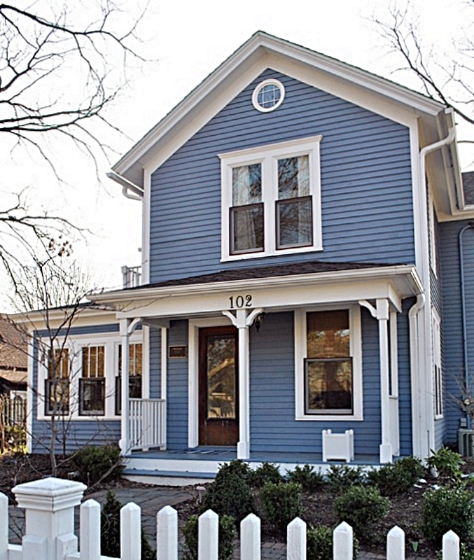 Blue Historic House with White Picket Fence and Porch