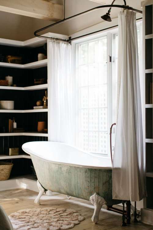 Vintage Bathtub with Book Shelves