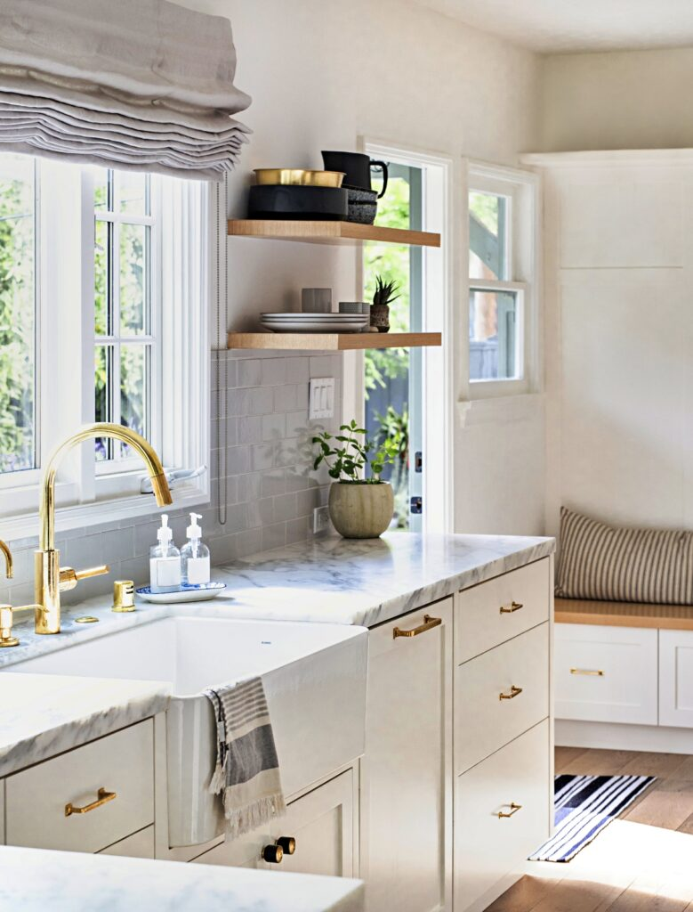 White Kitchen Cabinets with Brushed Gold Trim and Faucet