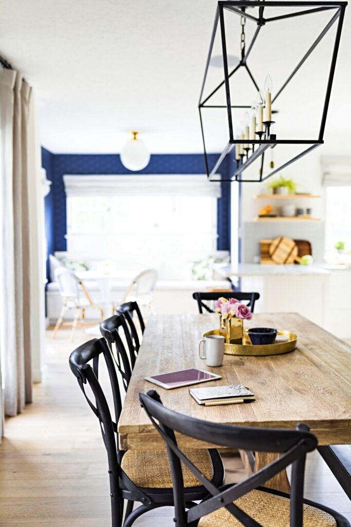 Farmhouse Table with Cross-Back Chairs in Beach Style Kitchen