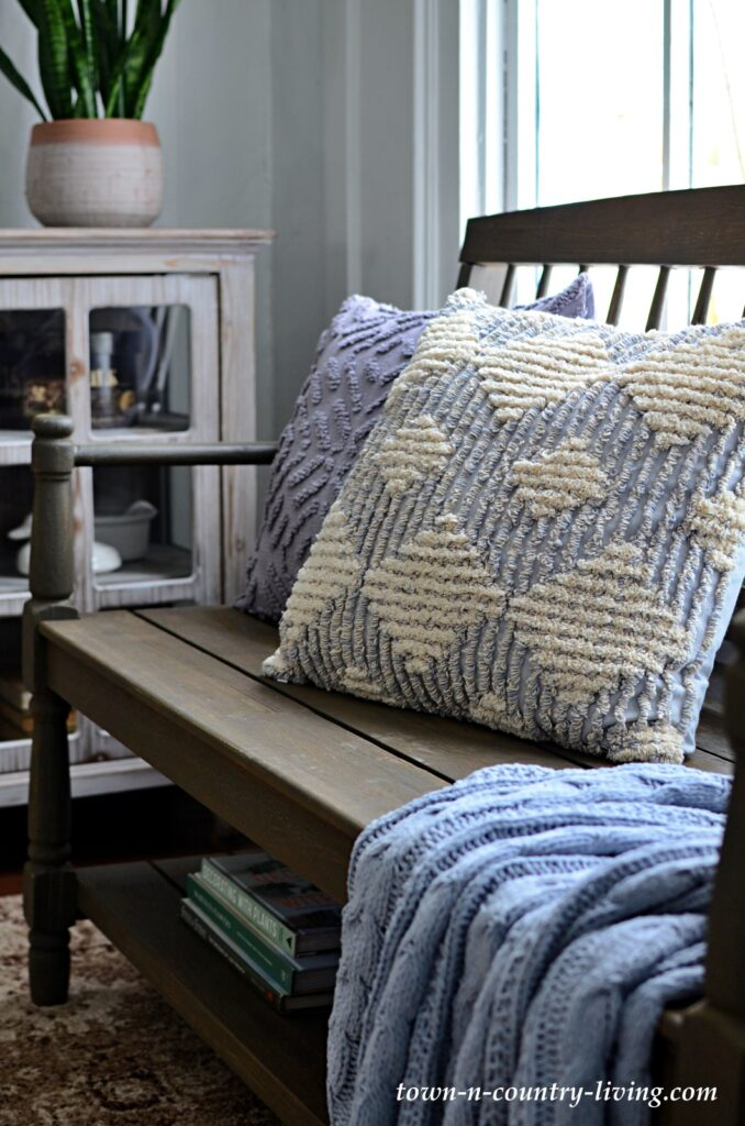 Wooden Bench with Textured Gray Pillows