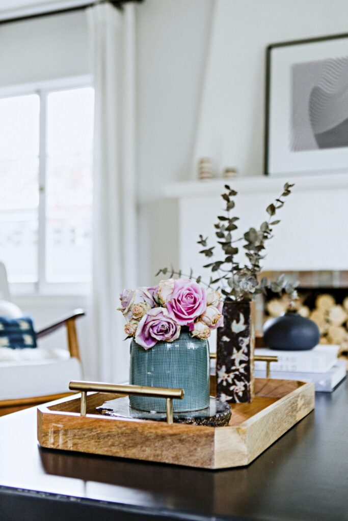 Flowers on a table by the fireplace in minimalist living room