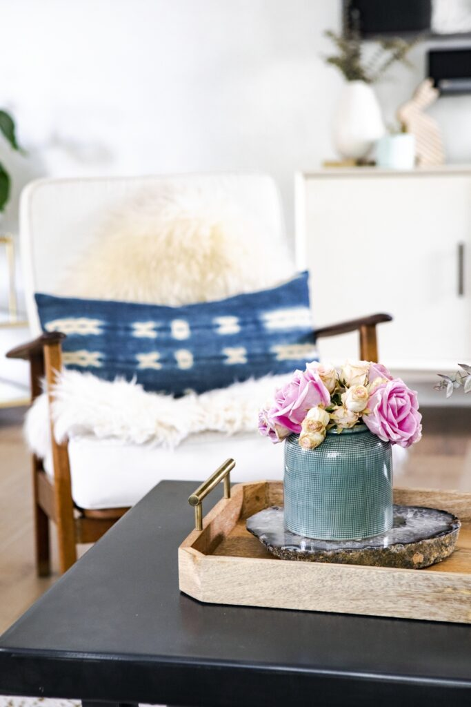 Roses on a wooden table in boho chic living room