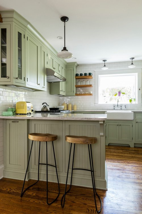 Light Green Cabinets in Classic Kitchen with Wood Floors