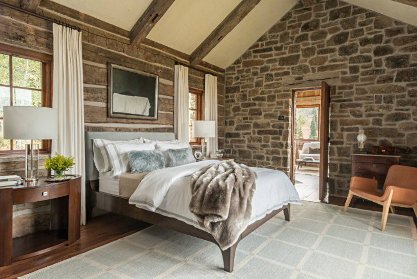 Beautiful Cabin Style Bedroom with Stone Walls