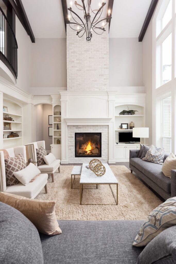 Floor to Ceiling Light Gray Stone Fireplace
