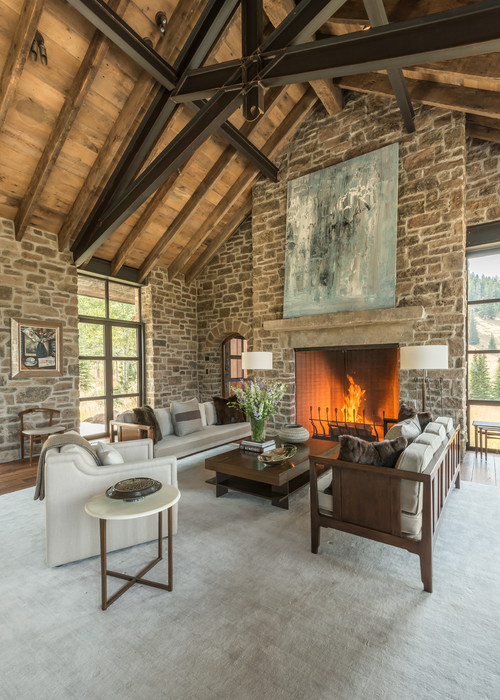 Rustic Stone-Walled Living Room with Wood Vaulted Ceiling