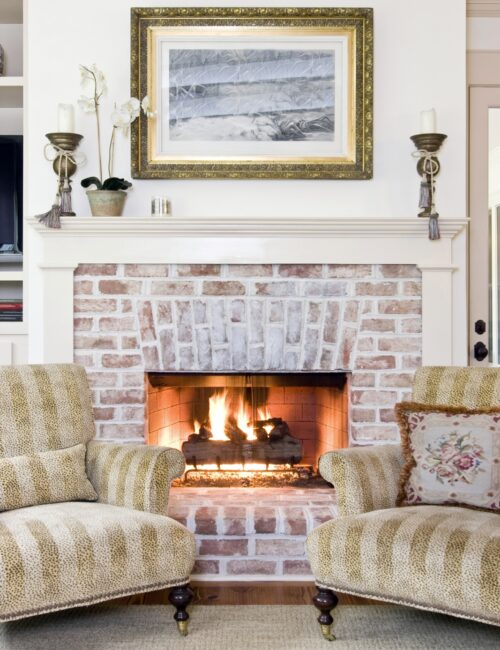 Matching Chairs in Front of White Brick Fireplace