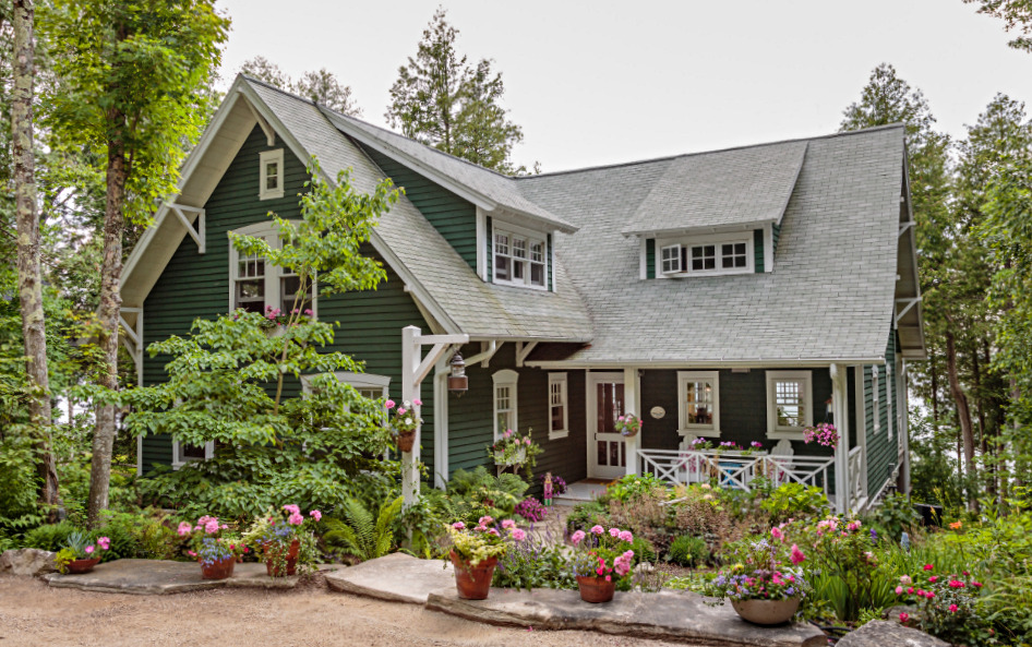 Dark Green and White Cottage with Flowers in Front