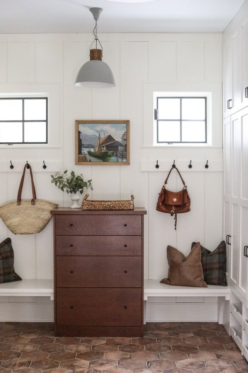Modern Country Mud Room with Coat Hooks and Planked Walls