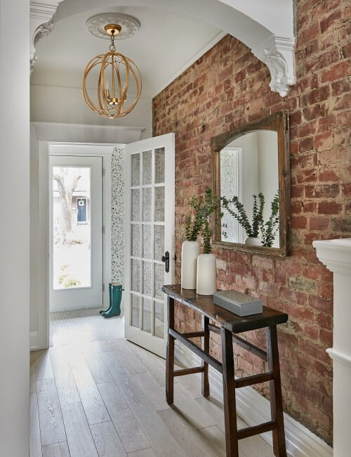 Home Entryway with Brick Wall