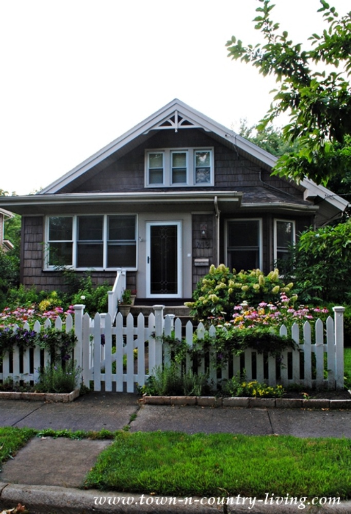 Gray Cottage Bungalow with White Picket Fence