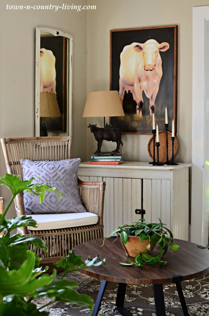 Country Style Sitting Room with Vintage Cabinet and Rattan Chair