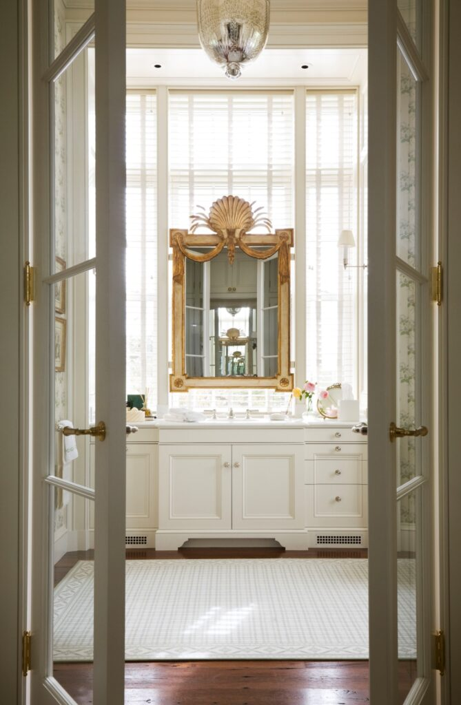 French doors leading to bathroom in a traditional home