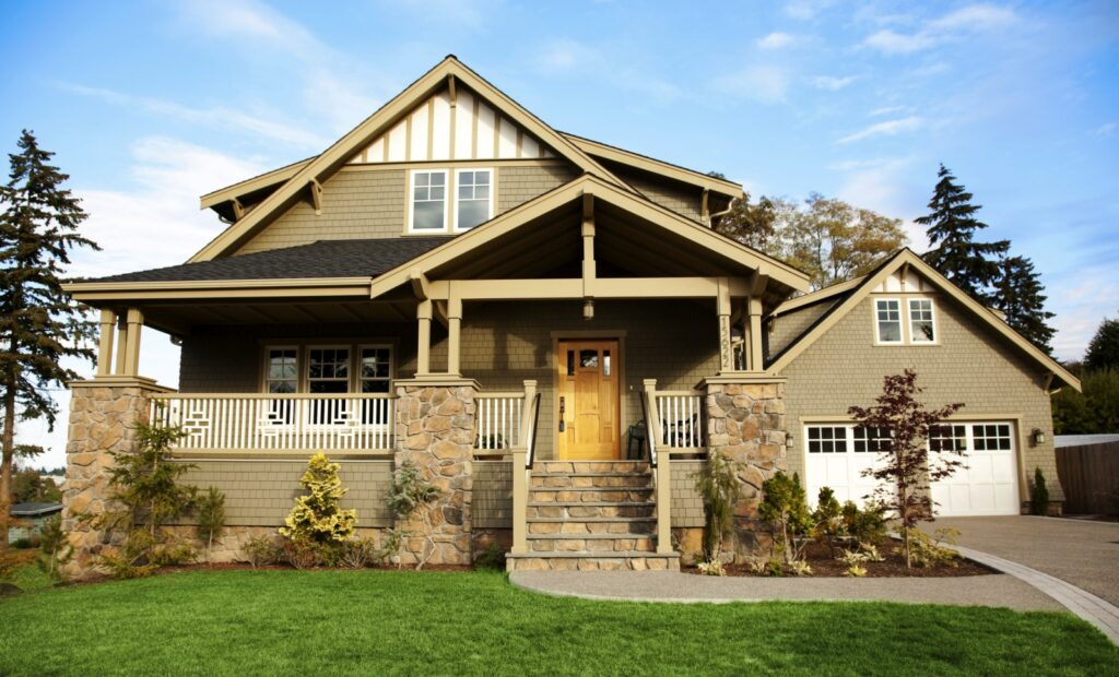 Beautiful example of a craftsman style home with a porch and low slung roof