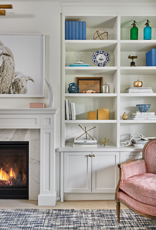 White Bookcase by Fireplace in Living Room