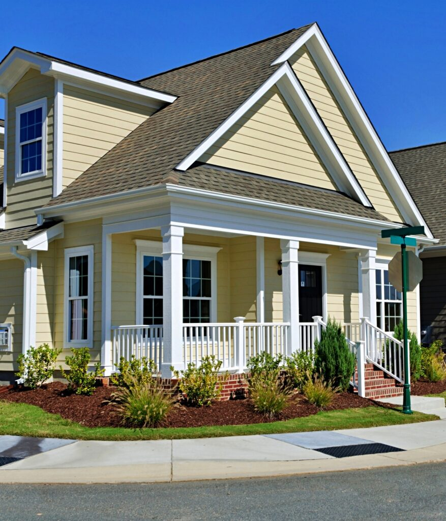 Light yellow craftsman home with porch