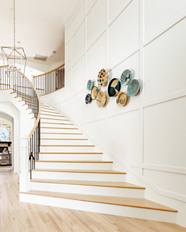 Modern Glam Staircase with Baskets on Wall