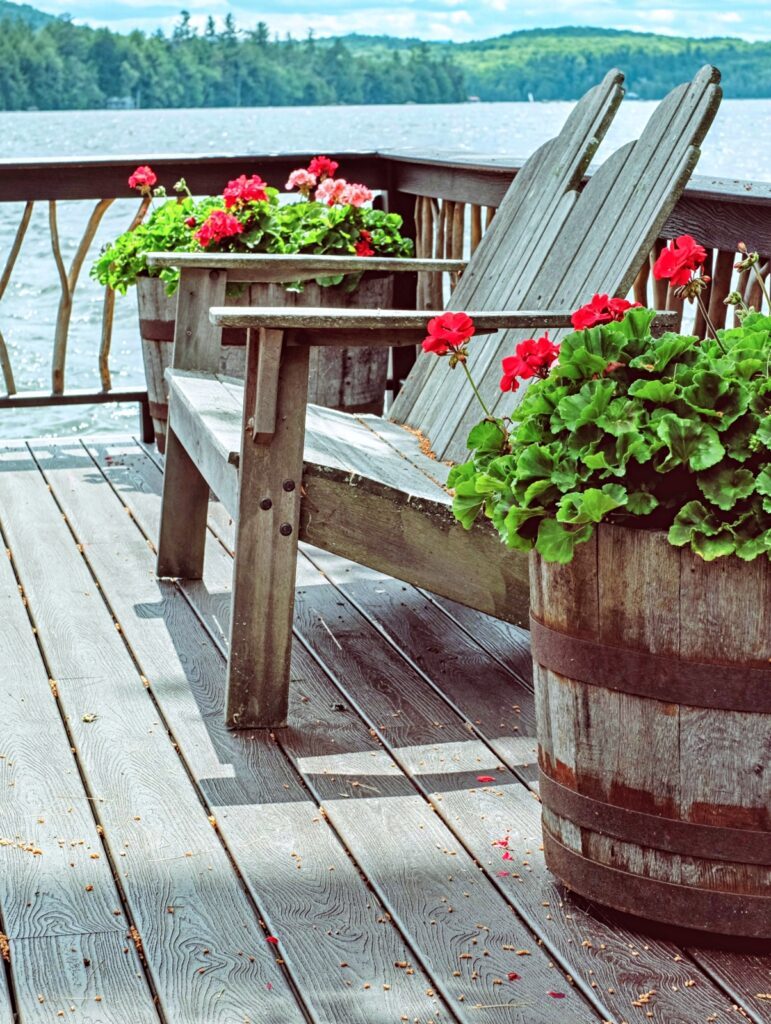 Wooden deck at Lake cabin with Adirondack chairs