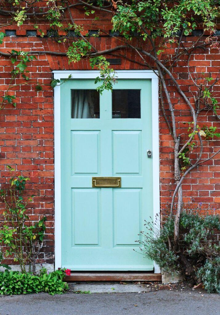 Brick House in London with Aqua Front Door