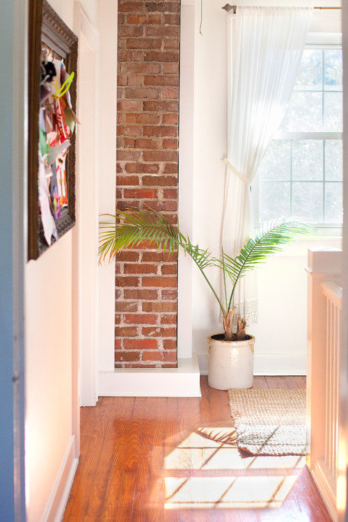Upstairs Hallway with exposed brick chimney