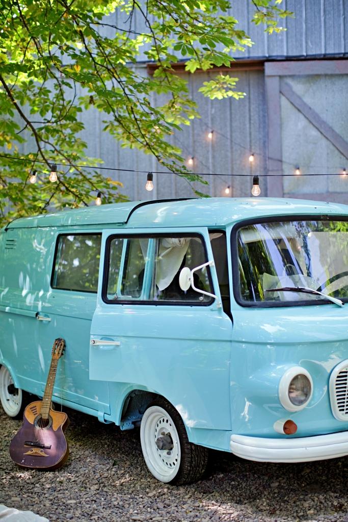 Classic vintage blue camper van parked in the park.