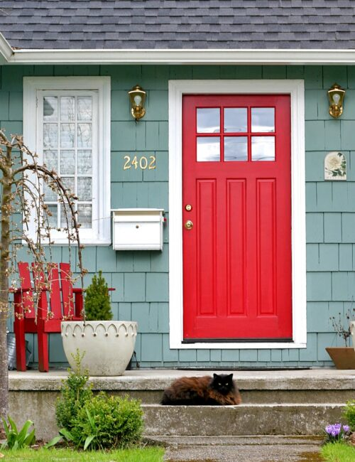 Red Door on Blue Cottage