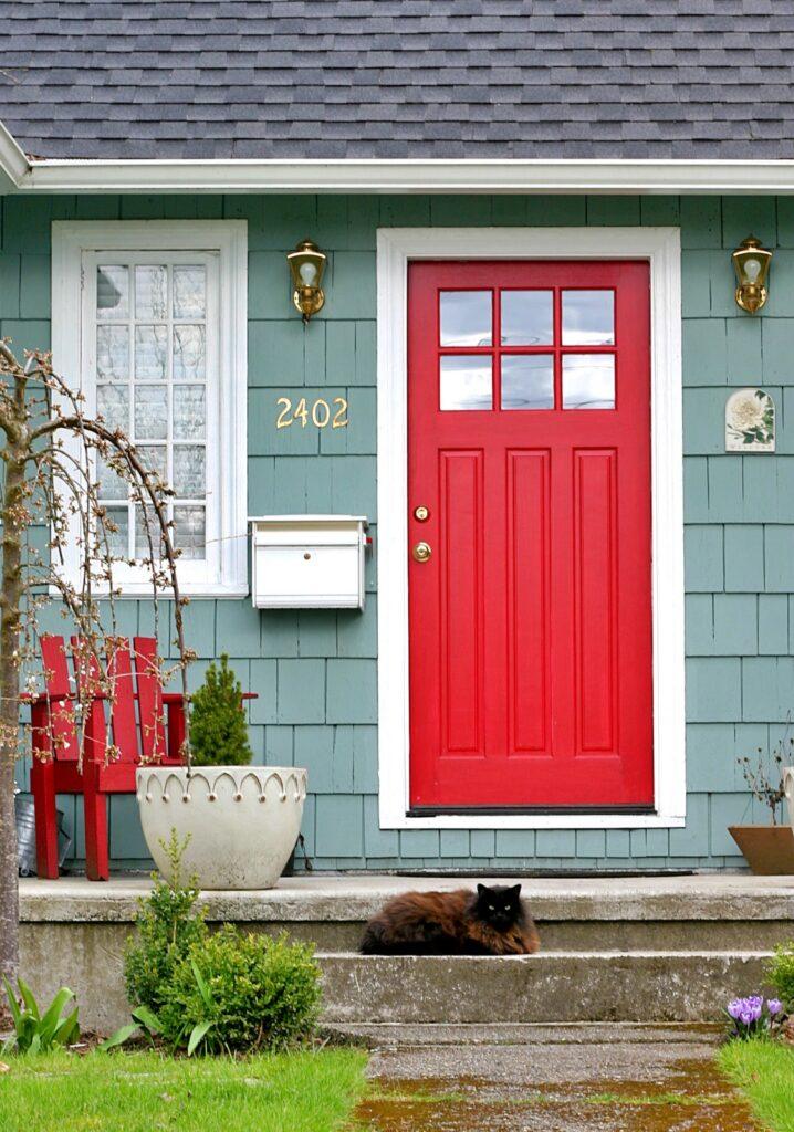 Red Door on Blue Cottage
