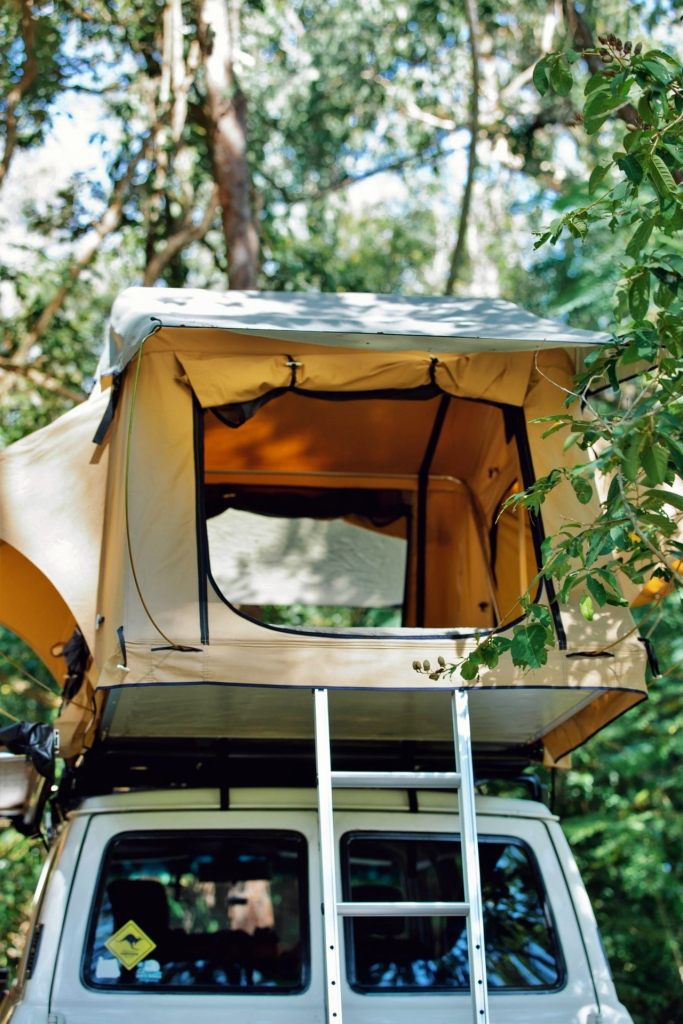 SUV with pop-up tent for elevated sleeping