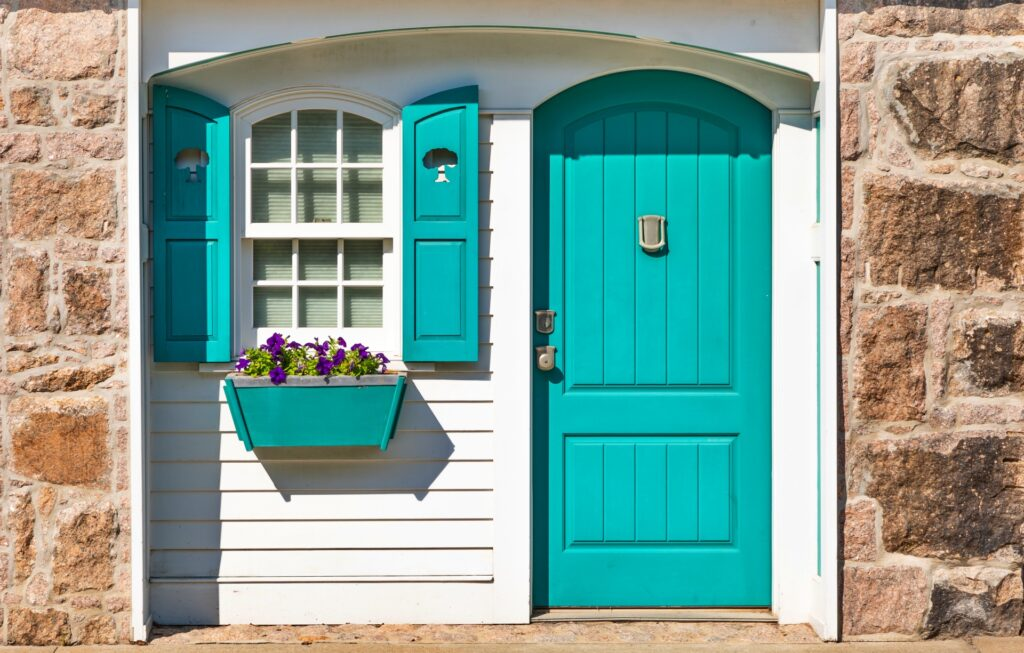 Turquoise Arched Door with Shuttered Window