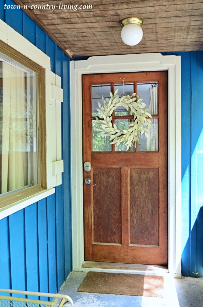 Solid Wood Front door with Window on Cozy Blue Cottage