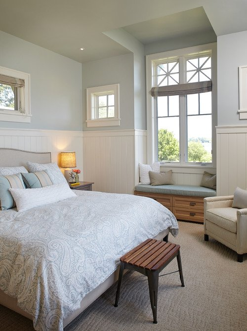 Serene, pale blue master bedroom with bump-out window