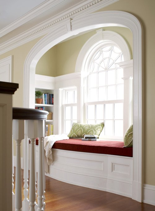 Elegant Archway with Reading Nook on Stair Landing