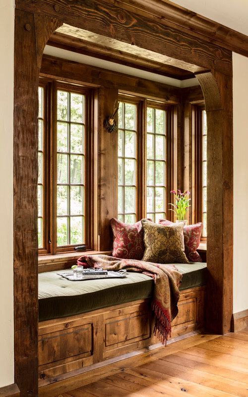 Wood trimmed windows with built-in cubby seat