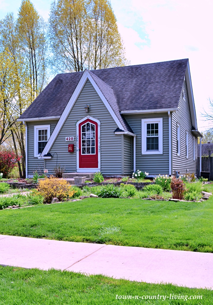 Light Gray Tudor Home with Red Front Door