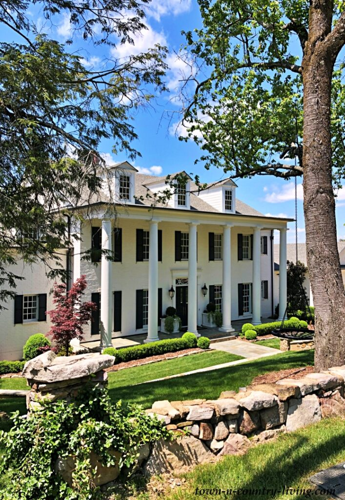 Grand White Southern Home with a Pillared Porch