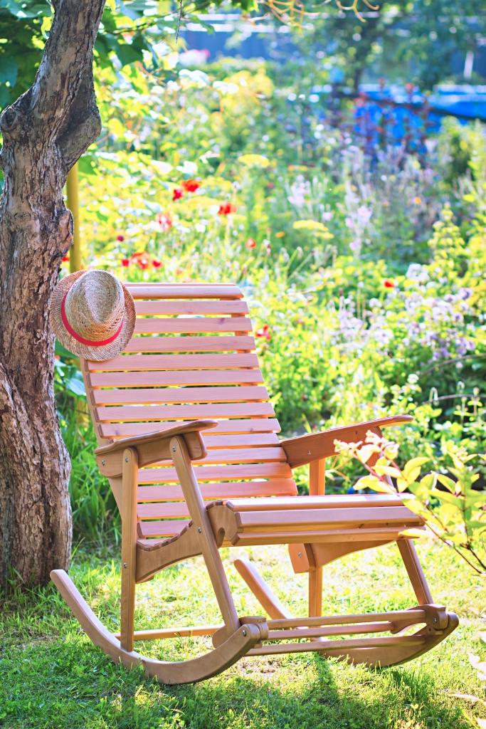 Outdoor Wooden Rocking Chair in Summer Garden