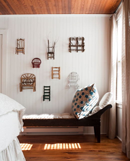 Tiny Chairs on Wall in Cottage Bedroom
