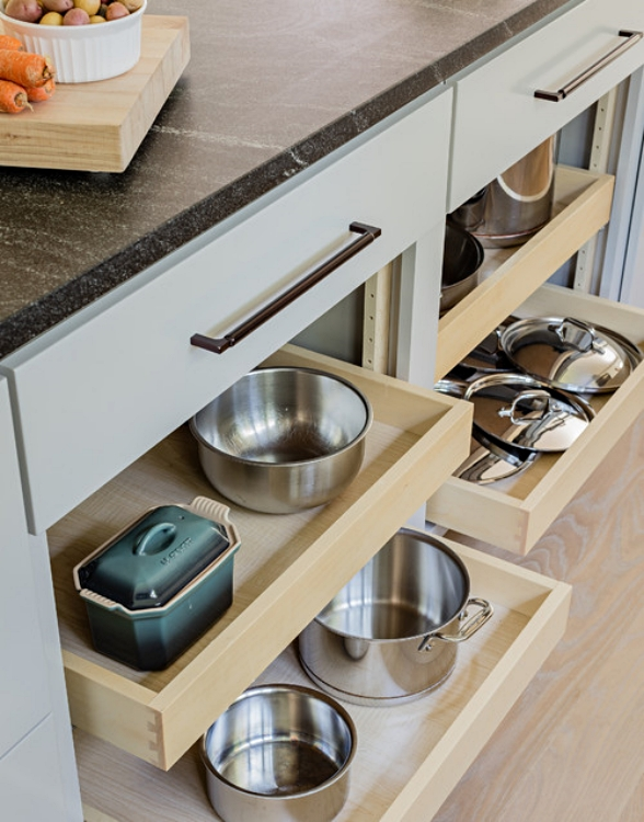 Pull-out shelves inside kitchen cabinets for easy storage and access