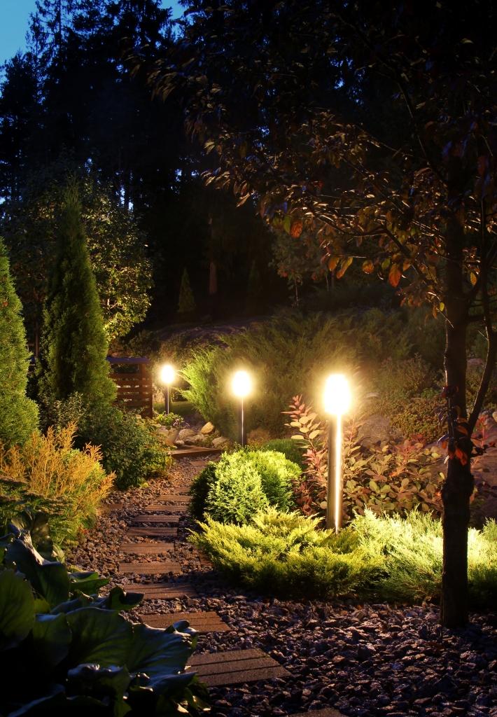 Illuminated home garden path patio lights in evening dusk