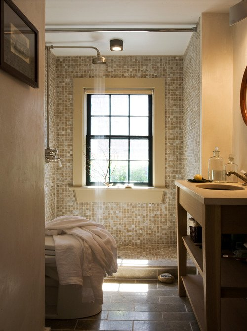 Tiled bathroom with rain shower head in sustainable home