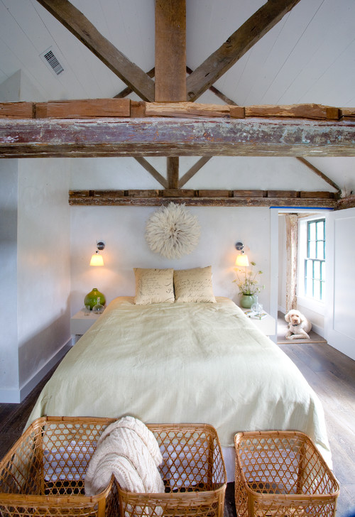 Creamy Bedroom with Vaulted Ceiling and Old Wood Beams