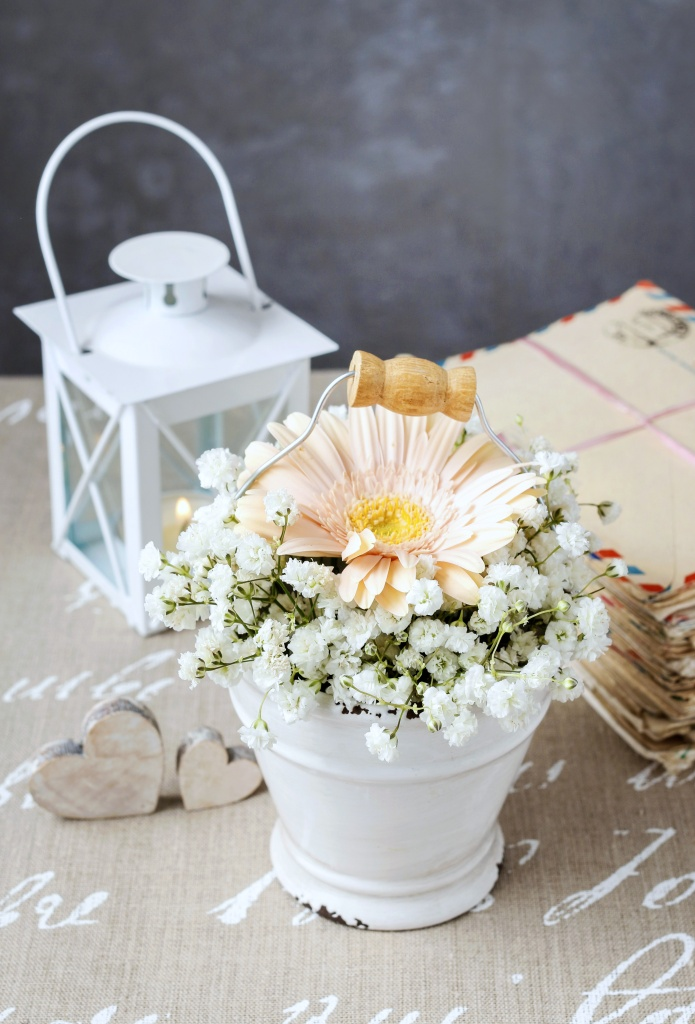 Floral arrangement with peach gerbera flower and baby's breath
