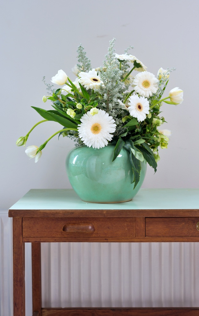 White gerbera daisies in a turquoise vase