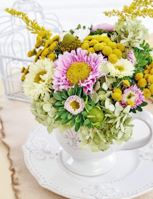 Beautiful summer flowers arranged in a white soup tureen.
