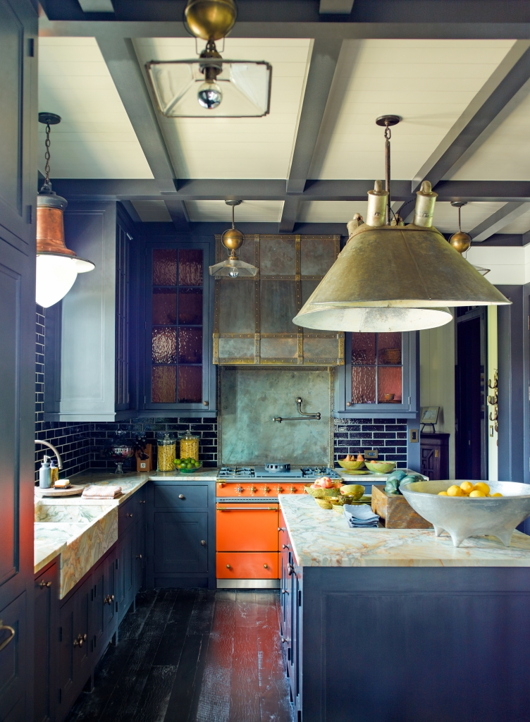 Dark blue-gray cabinets in a country estate kitchen